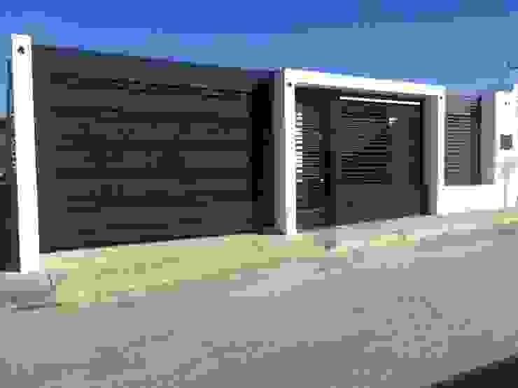 FACHADA MINIMALISTA Casas modernas de Arq. Alberto Quero Moderno Concreto