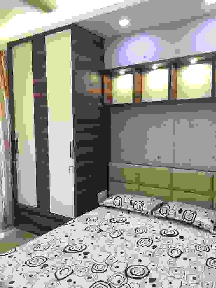 http://www.greenhatstudio.in/jitu-interior/ Modern style bedroom by GREEN HAT STUDIO PVT LTD Modern