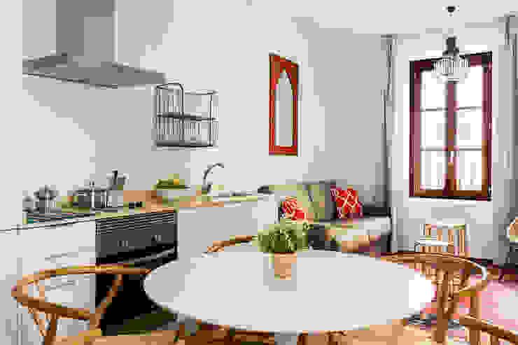 Mediterranean style dining room by StudioBMK Mediterranean