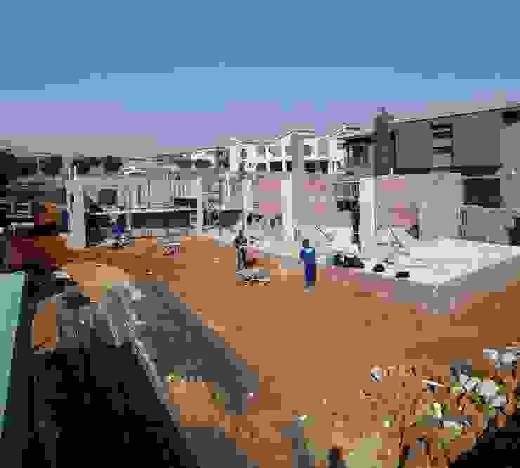 ground floor slab complete: modern  by Seven Stars Developments, Modern