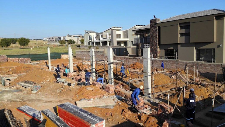 first storey columns complete: modern  by Seven Stars Developments, Modern