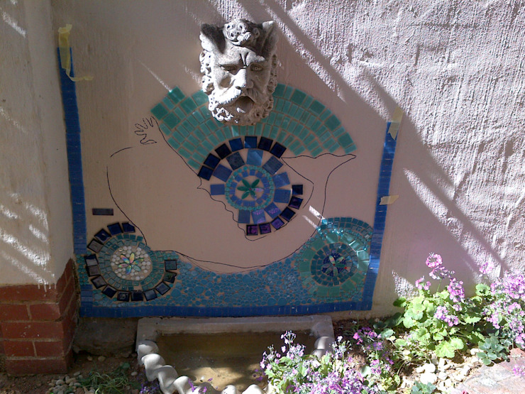 Mosaic in progress on a wall by SOJE Interior, Design and Decor PTY (Ltd)