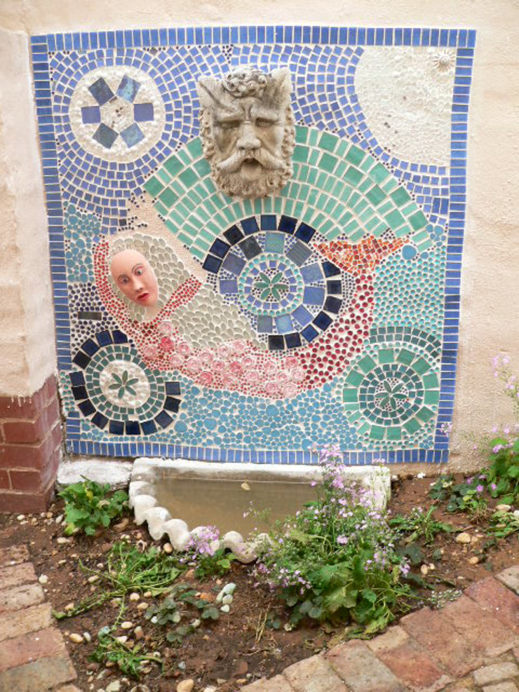Mosaic on the wall at a fountain by SOJE Interior, Design and Decor PTY (Ltd)