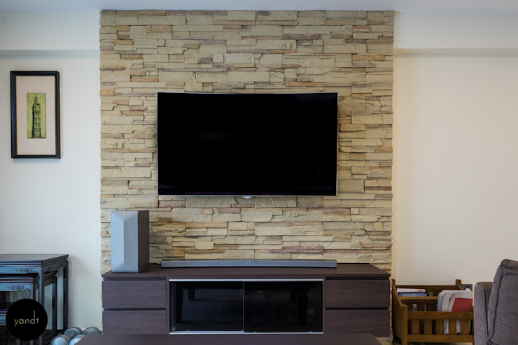 TV console and feature wall Asian style living room by Y&T Pte Ltd Asian Stone