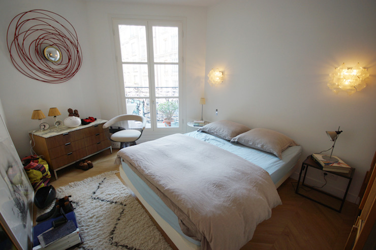 Rénovation appartement Paris, quartier Montmartre: Chambre de style  par Grazia Architecture, Moderne