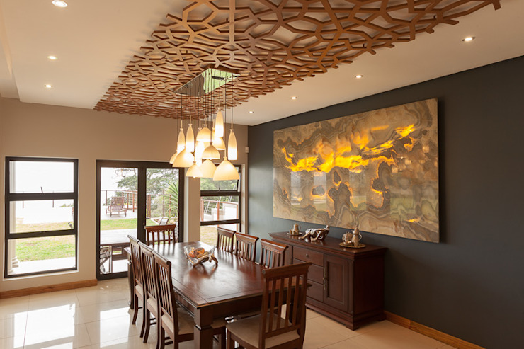 House Naidoo:  Dining room by Redesign Interiors,