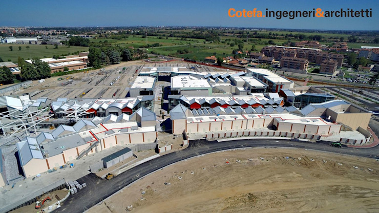 Scalo Milano Centri commerciali in stile industrial di Cotefa.ingegneri&architetti Industrial