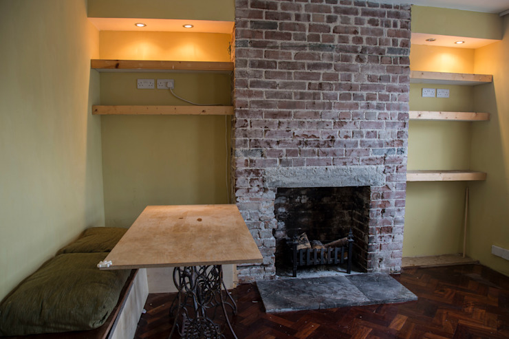 Refurbished fire place with limestone hearth and built in bench Research + Design