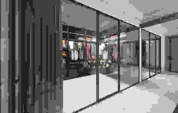 Vestidores y closets de estilo  por Студия дизайна интерьера в Москве 'Юдин и Новиков',