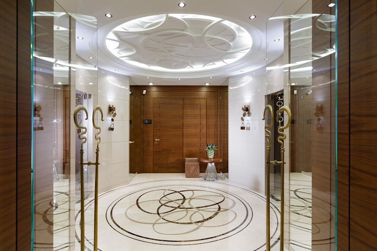 Pasillos, vestíbulos y escaleras de estilo moderno de Студия дизайна интерьера в Москве 'Юдин и Новиков' Moderno