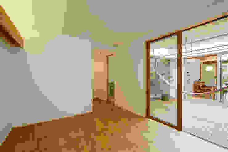 Moderne Schlafzimmer von スタジオグラッペリ 1級建築士事務所 / studio grappelli architecture office Modern