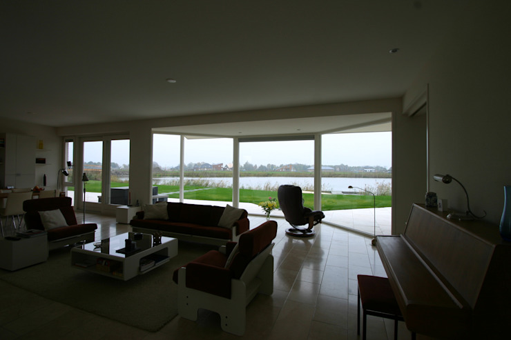 Country style living room by buro voor advies en architectuur pieter e. bolhuis Country Stone