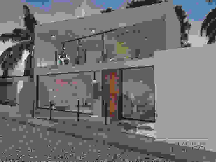 Fachada / vista lateral Estudios y despachos modernos de Espacio en Blanco Moderno