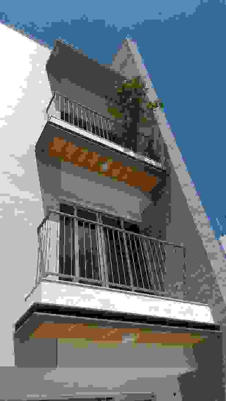 台南吾居 現代房屋設計點子、靈感 & 圖片 根據 兆博建築 現代風