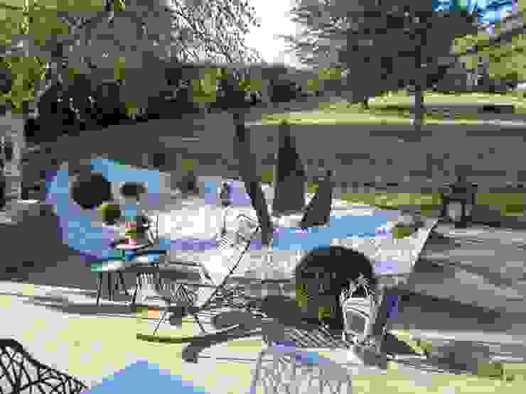 Une véritable jonction entre le lieu de vie et l'espace engazonné Jardin moderne par Berger Jardins Moderne
