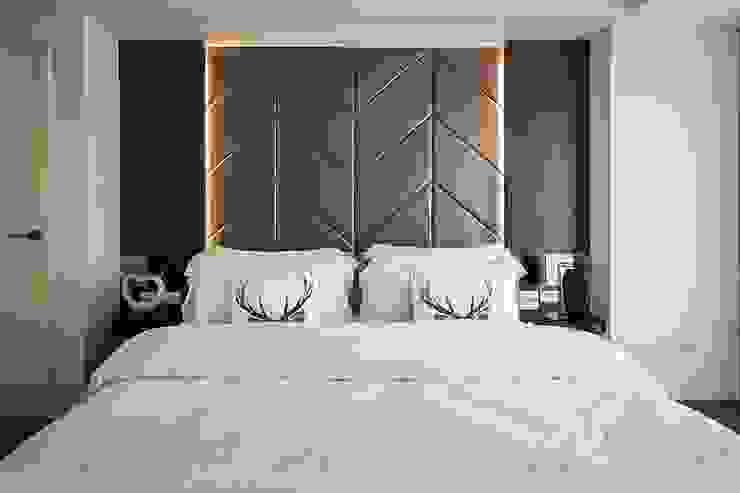 Camera da letto moderna di 你你空間設計 Moderno