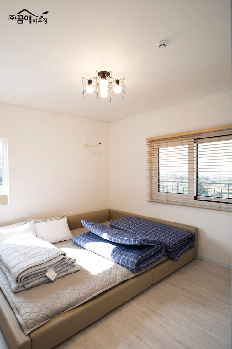 꿈애하우징 Camera da letto moderna