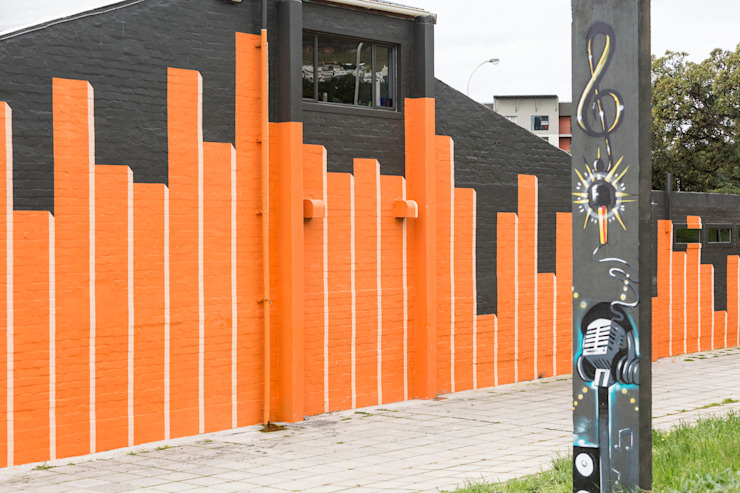 wall art to make something interesting & visible of an otherwise bland (existing) facade by Till Manecke:Architect Modern