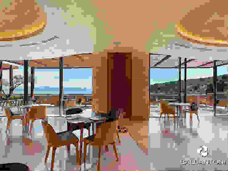 Immagine del Ristorante Portofino, situato a Paliouri, in una delle più belle coste della Grecia. Baldantoni Group Sala da pranzo moderna Argento / Oro Giallo