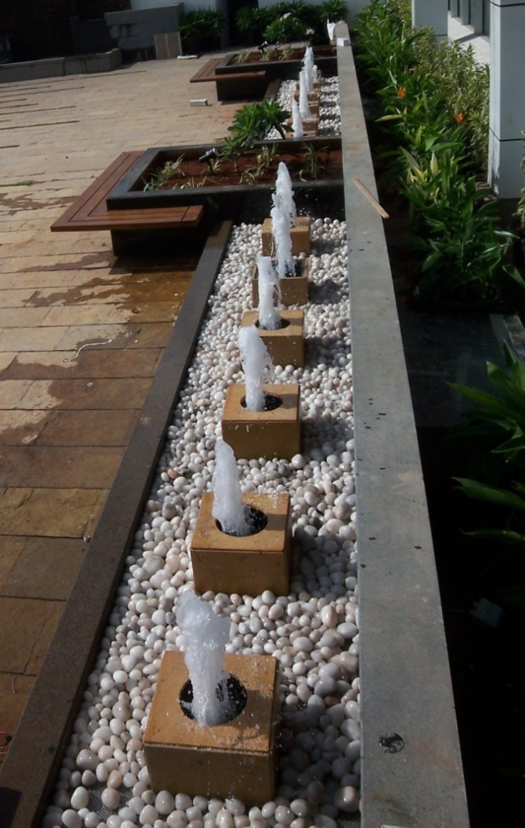 water fountain by Land Design landscape architects Tropical