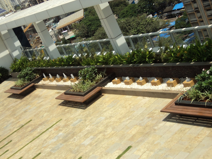 seats with planters by Land Design landscape architects Tropical
