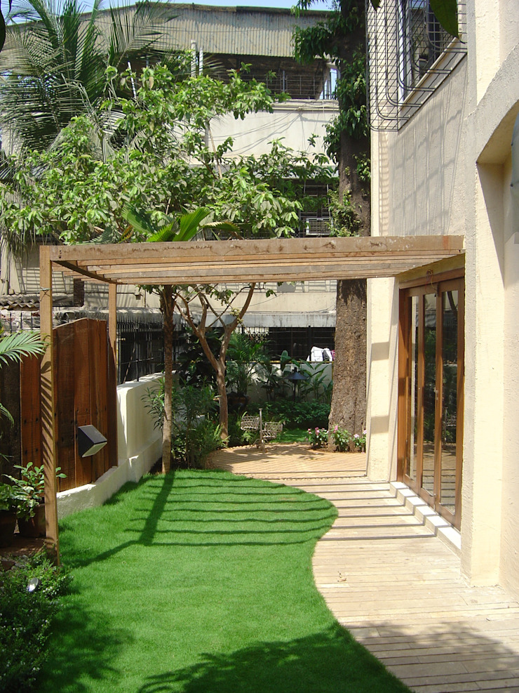 Garden landscape for Bungalow at Chembur Tropical style garden by Land Design landscape architects Tropical