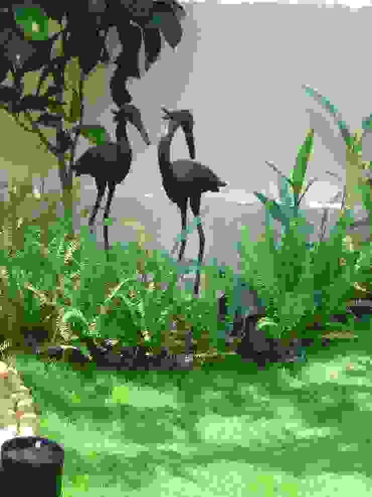 Metal Sculpture Tropical style garden by Land Design landscape architects Tropical