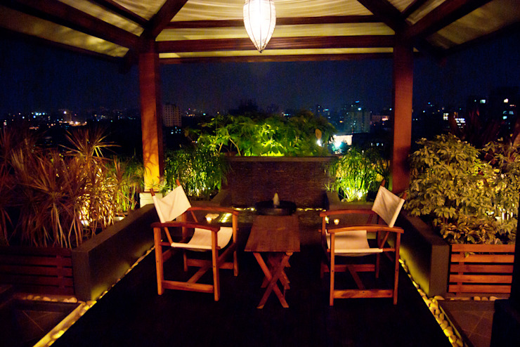 Covered sitting area Modern garden by Land Design landscape architects Modern