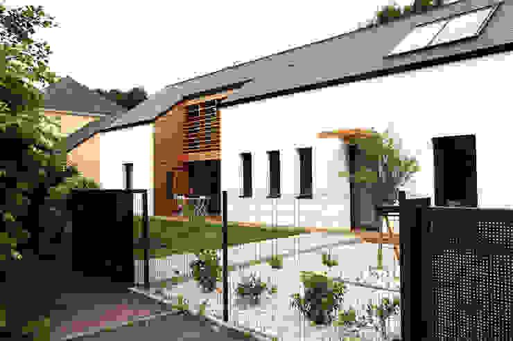 maison ossature bois Maisons classiques par yg-architecte Classique Calcaire