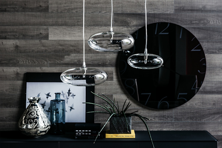 A stunning elliptical orb available in two sizes with various combinations. IQ Furniture Living roomLighting