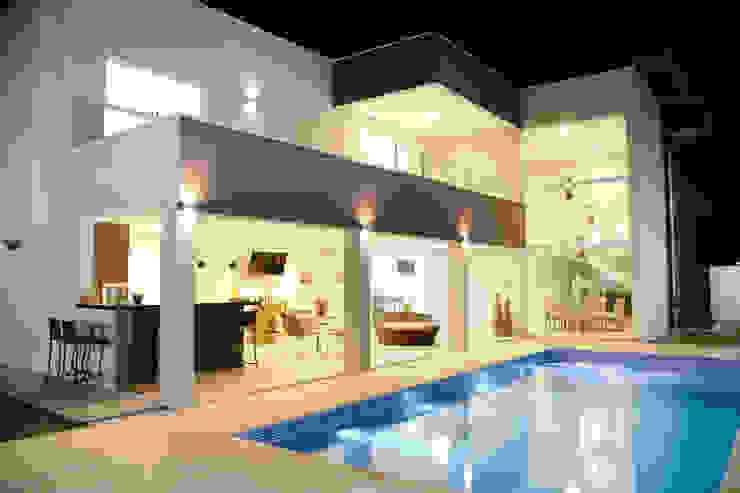 Casa M&C Híbrida Arquitetura, Engenharia e Construção Piscinas modernas