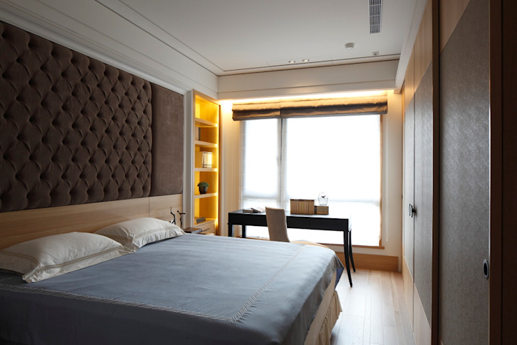 實木皮的美式線條:  臥室 by 誼軒室內裝修設計有限公司