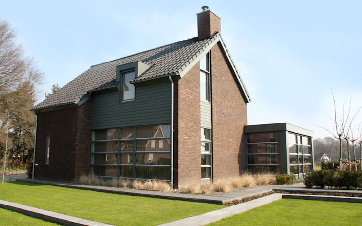 Country style house by bureau voor architectuur aujourd´hui boekel Country