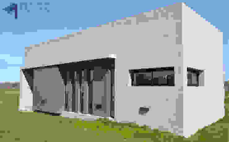 Frente Casas modernas: Ideas, imágenes y decoración de Estudio Pauloni Arquitectura Moderno