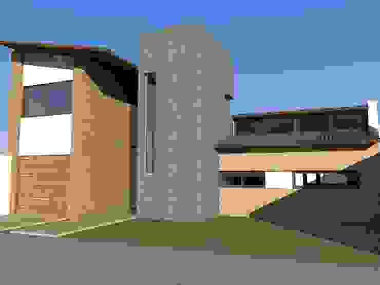 Propuesta Frente Casas rústicas de JIEarq Rústico Ladrillos