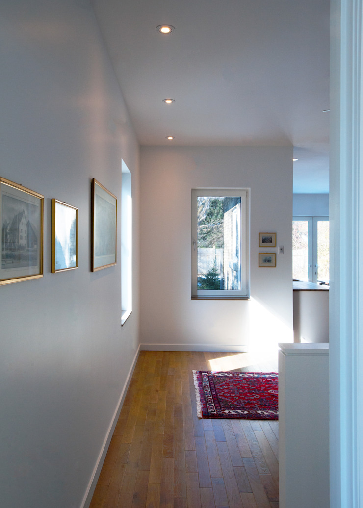 Guelph Deep Energy Retrofit Minimalist corridor, hallway & stairs by Solares Architecture Minimalist