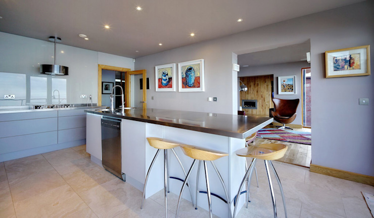 A large Island perfect for Relaxed Family Eating Modern kitchen by ADORNAS KITCHENS Modern Wood Wood effect