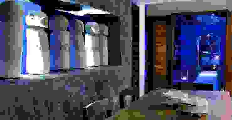 Lava stone wall in Villa in Ubud: tropical  by Resort The Purist Villas Bali, Tropical Stone