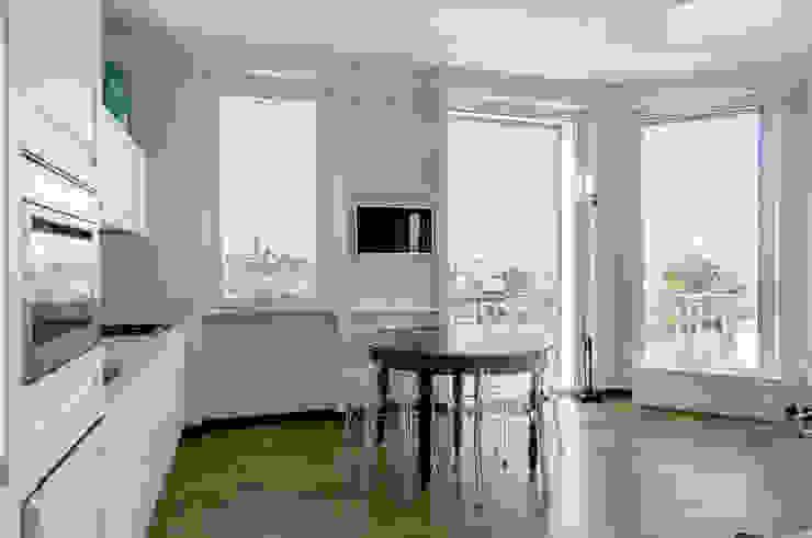 Appartamento Privato Sala da pranzo moderna di Officina29_ARCHITETTI Moderno Legno Effetto legno