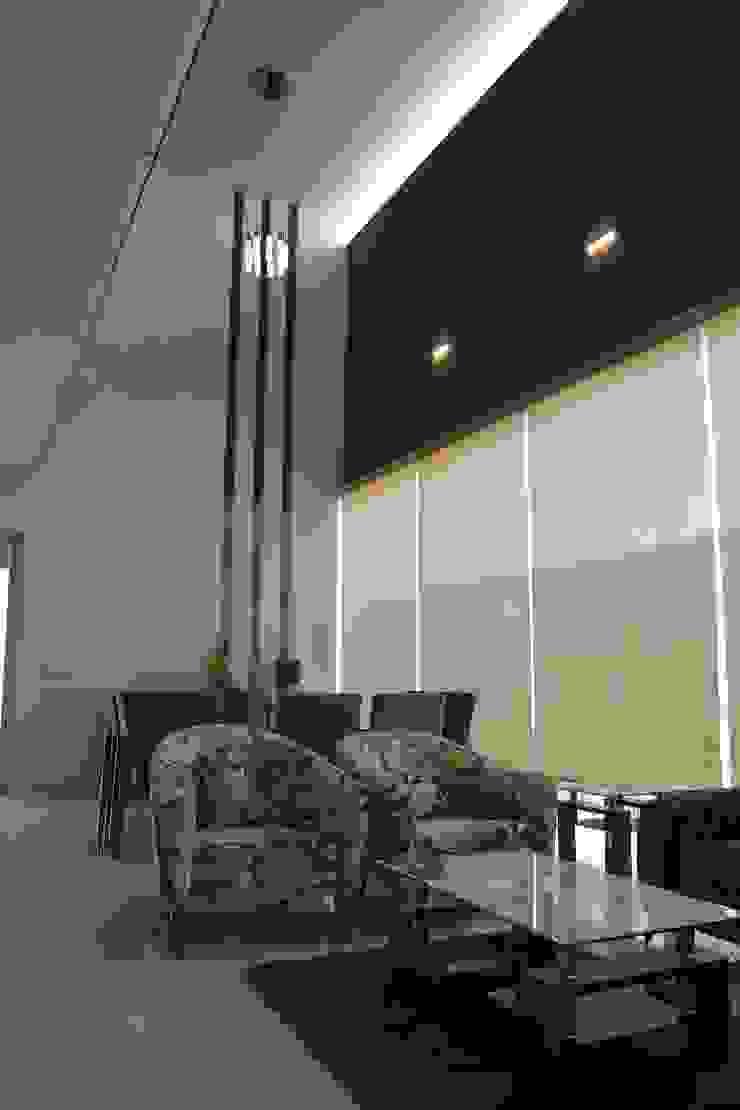 Salas de estar modernas por arketipo-taller de arquitectura Moderno