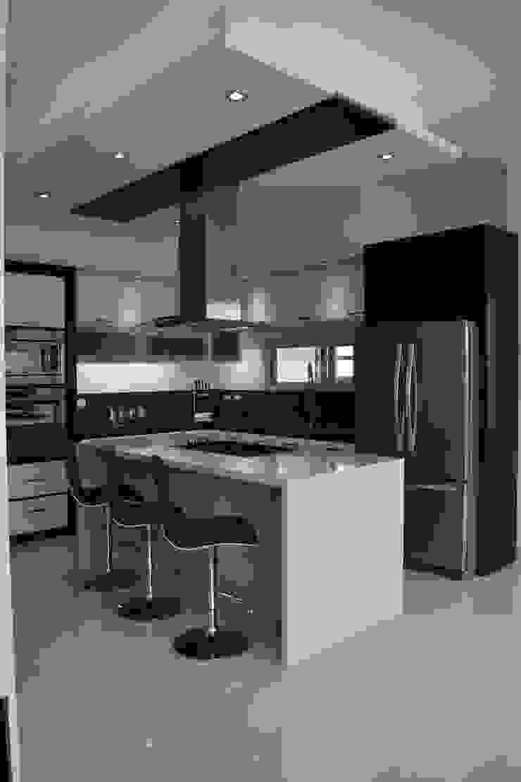 Cozinhas modernas por arketipo-taller de arquitectura Moderno