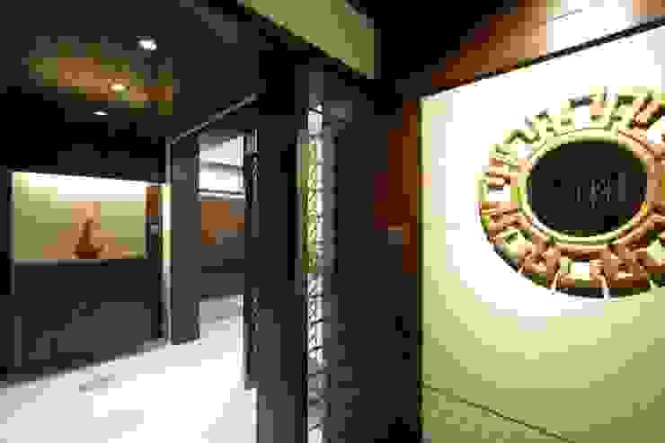 Mr vora's flat Asian style corridor, hallway & stairs by studio 7 designs Asian