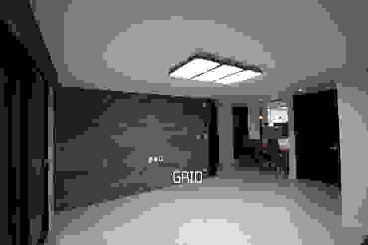 30평대 거실 인테리어 모던스타일 거실 by Design Studio Grid+A 모던 타일