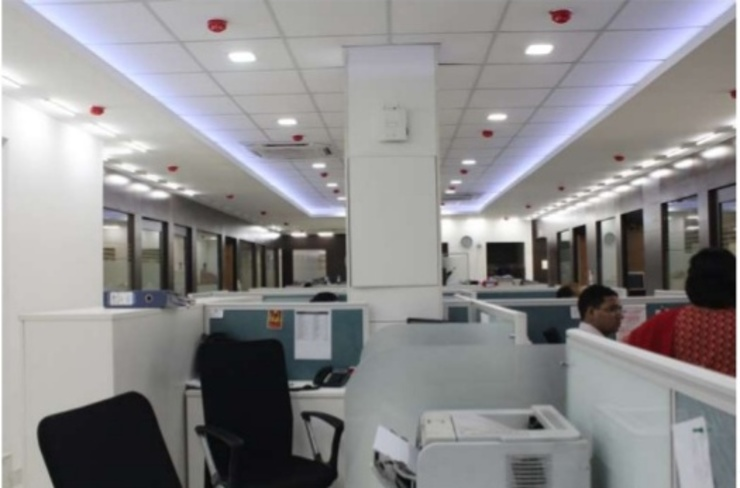CORPORATE OFFICE INTERIORS, STATCON ENERGIA, NOIDA: modern  by DESINNOVA,Modern