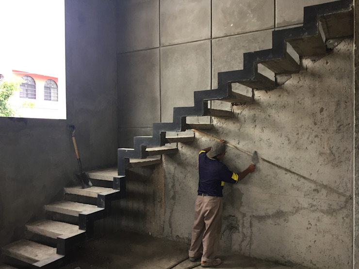 Projekty,  Korytarz, przedpokój zaprojektowane przez Ma&Co , Minimalistyczny Wzmocniony beton