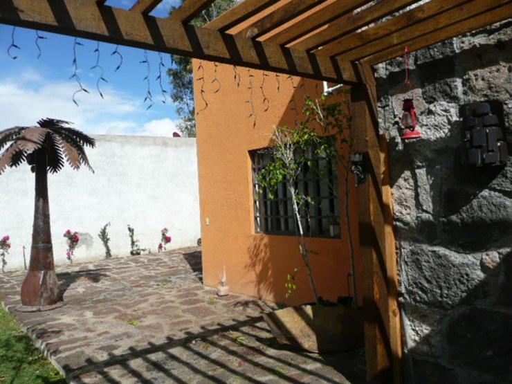 Pérgola Alberto M. Saavedra Balcones y terrazas rústicos