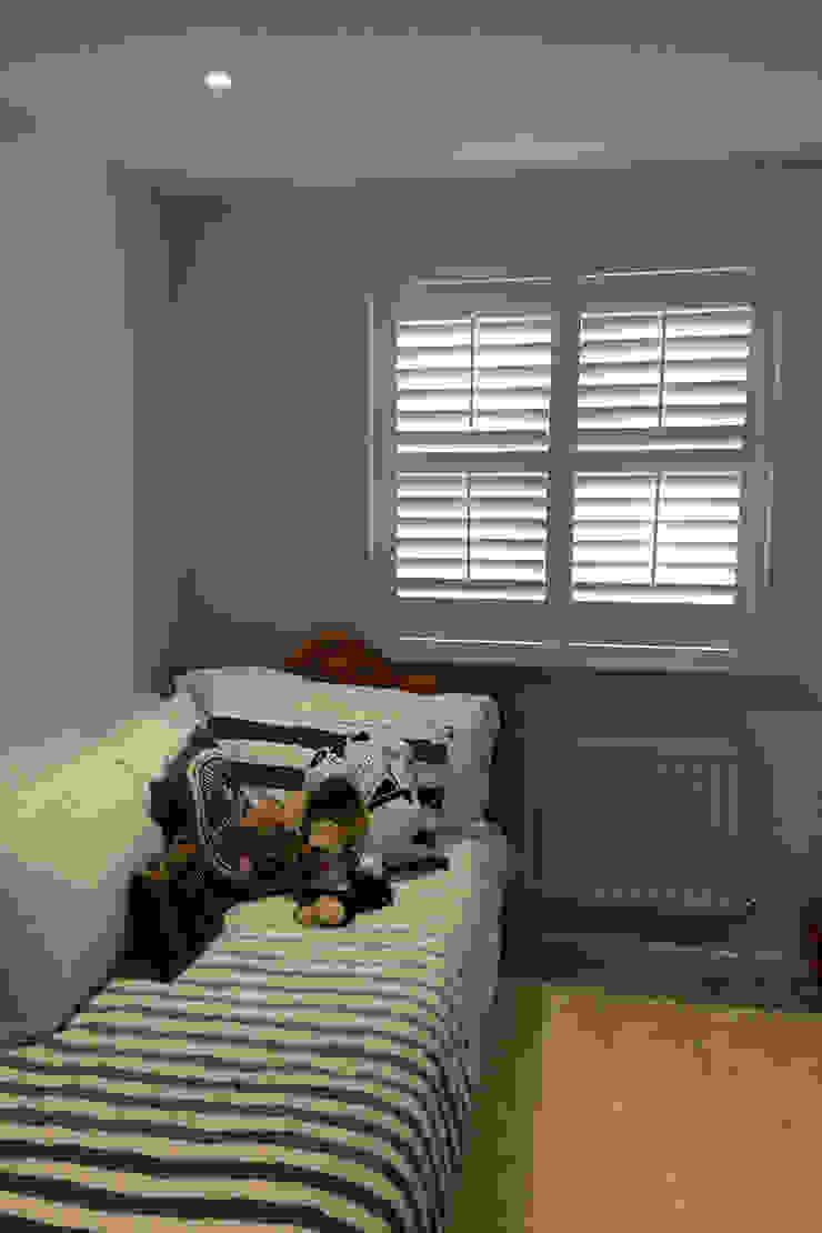 Full height shutters for kids bedroom windows: modern  by Plantation Shutters Ltd, Modern Wood Wood effect