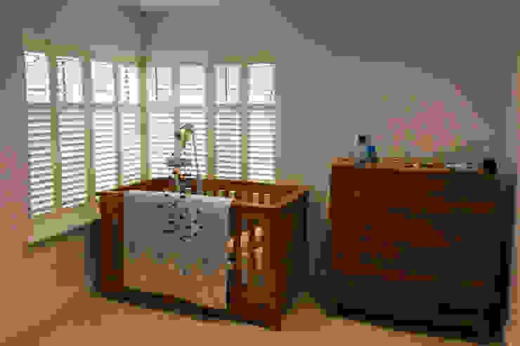 Full height shutters for sash windows: modern  by Plantation Shutters Ltd, Modern Wood Wood effect