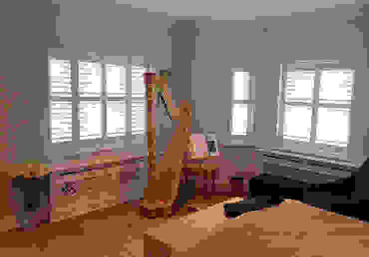 Full height shutters for bedroom windows: modern  by Plantation Shutters Ltd, Modern Wood Wood effect