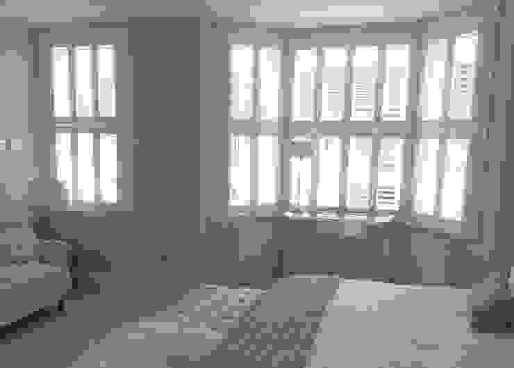 Bedroom shutters for sash and bay windows: modern  by Plantation Shutters Ltd, Modern Wood Wood effect